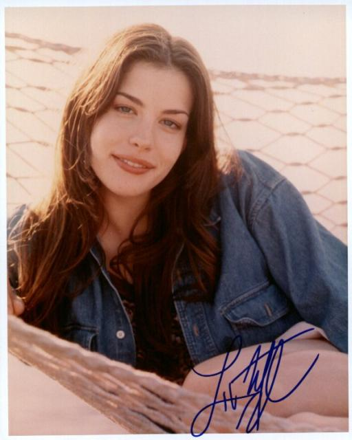 Liv Tyler 3 (10x8)   Mostly good Signature but 1st letter smudged.
