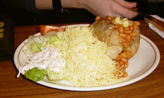 Chip Shop's version of a Baked Potato with cheese, beans and salad.