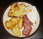 Buck Rarebit with bacon and roast potatoes.