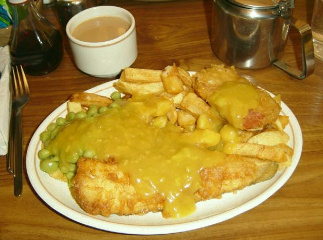 Fish, chips, mushy peas, a Spam fritter and curry sauce.