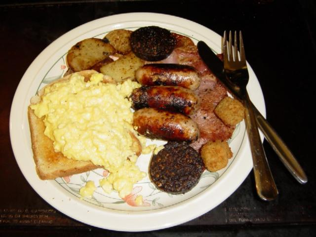 Sausage, black pudding, bacon, saute potatoes, scrambled egg on toast and something that could be breaded mushrooms.