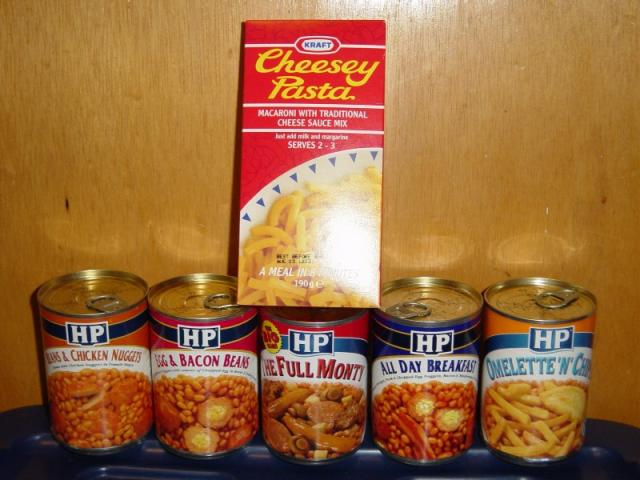 An assortment of complete-meals in a can (plus some vomit in a box).
