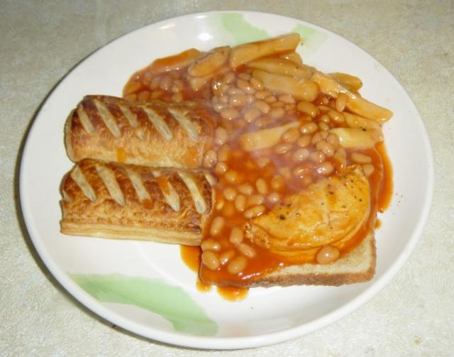 "A poor attempt to make a ""Meal in a can"" edible by adding toast and sausage rolls."