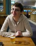 "An Icelandic Woman, drinking Belgian Beer, in a ""Mock British Pub"" in the middle of an English Airport. You can't say"