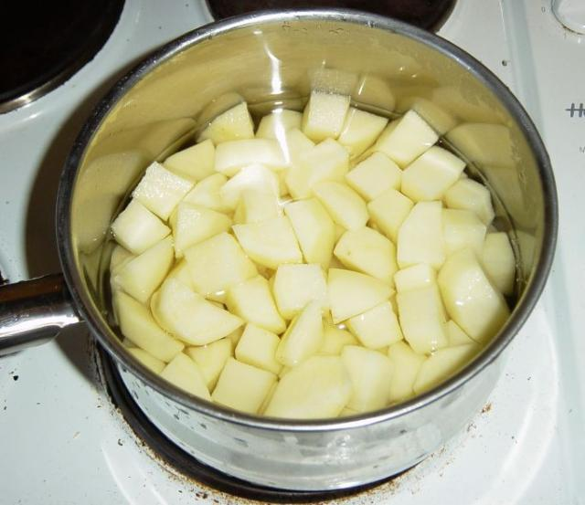 Chop the spuds up, and bung 'em in a pan with salt and boil them.
